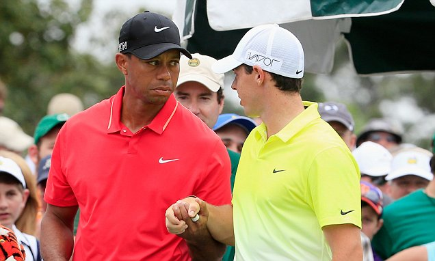 AUGUSTA, GA - APRIL 12: Tiger Woods of the United States (L) and Rory McIlroy of Northern Ireland wait on the first tee during the final round of the 2015 Masters Tournament at Augusta National Golf Club on April 12, 2015 in Augusta, Georgia. (Photo by Jamie Squire/Getty Images)